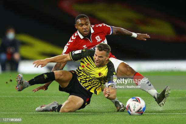 Tom Cleverley of Watford is brought down by Britt Assombalonga of Middlesbrough during the Sky Bet Championship match between Watford and...