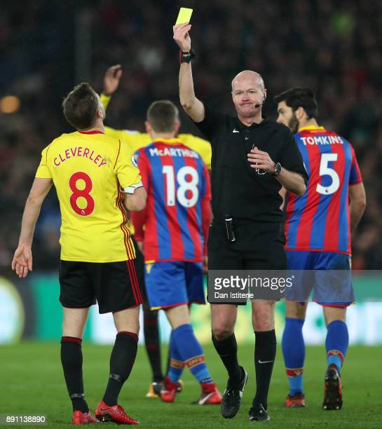 Tom Cleverley of Watford is shown a second yellow card by referee Lee Mason during the Premier League match between Crystal Palace and Watford at...