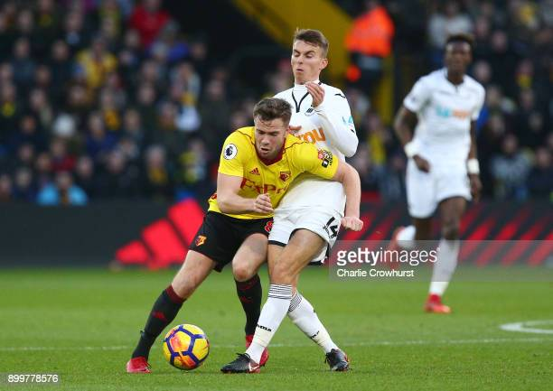 Tom Cleverley of Watford is tackled by Tom Carroll of Swansea City during the Premier League match between Watford and Swansea City at Vicarage Road...