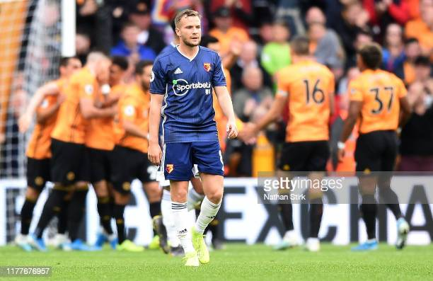 Tom Cleverley of Watford reacts after Wolverhampton Wanderers' second goal during the Premier League match between Wolverhampton Wanderers and...