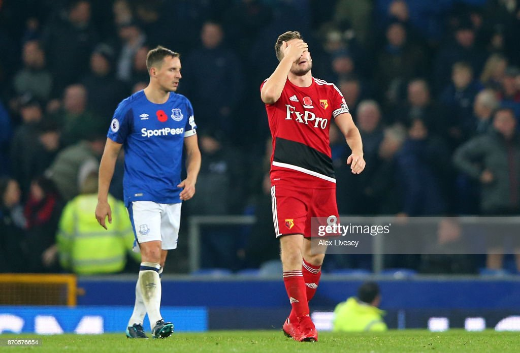Tom Cleverley of Watford reacts to missing a penalty during the Premier League match between Everton and Watford at Goodison Park on November 5, 2017 in Liverpool, England.