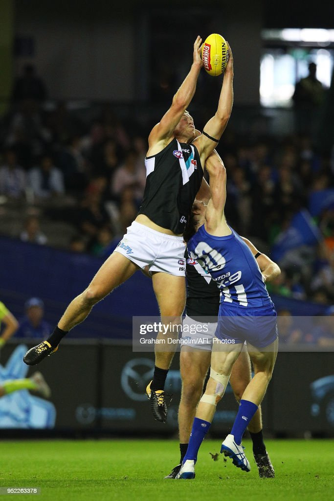 Tom Clurey of the Power takes a mark during the round six AFL match between the North Melbourne Kangaroos and Port Adelaide Power at Etihad Stadium on April 28, 2018 in Melbourne, Australia.