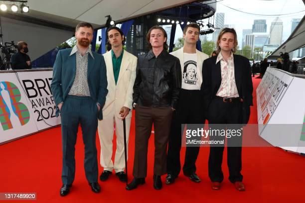Tom Coll, Carlos O'Connell, Conor Curley, Grian Chatten and Conor Deegan III of Fontaines DC arrives at The BRIT Awards 2021 at The O2 Arena on May...
