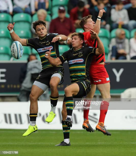 Tom Collins and Piers Francis of Northampton contest the high ball with David Strettle during the Gallagher Premiership Rugby match between...