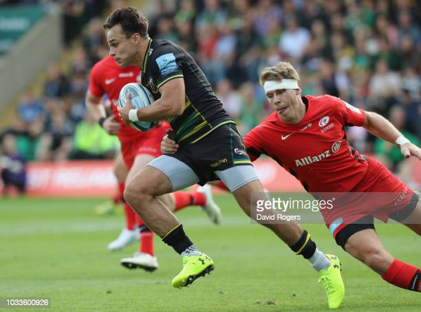 Tom Collins of Northampton breaks away from Liam Williams during the Gallagher Premiership Rugby match between Northampton Saints and Saracens at...