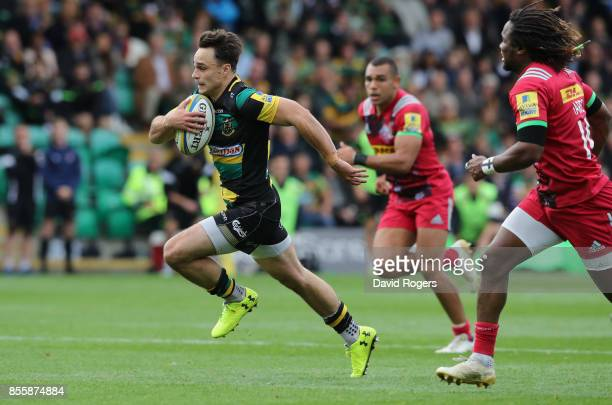 Tom Collins of Northampton breaks clear to score their second try during the Aviva Premiership match between Northampton Saints and Harlequins at...