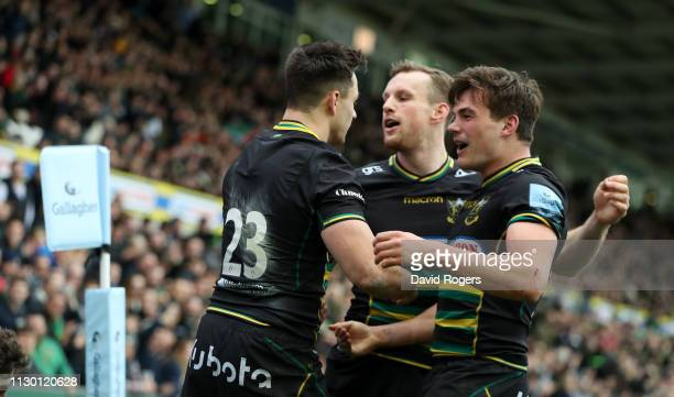 Tom Collins of Northampton Saints celebrates with team mates Rory Hutchinson and George Furbank after scoring a try during the Gallagher Premiership...
