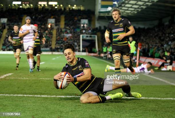 Tom Collins of Northampton Saints dives over for a try during the Premiership Rugby Cup match between Northampton Saints and Leicester Tigers at...