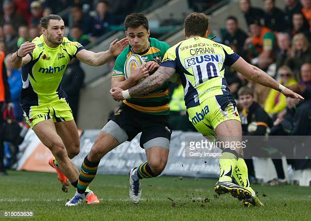 Tom Collins of Northampton Saints runs into the Sale Sharks defence during the Aviva Premiership match between Northampton Saints and Sale Sharks at...