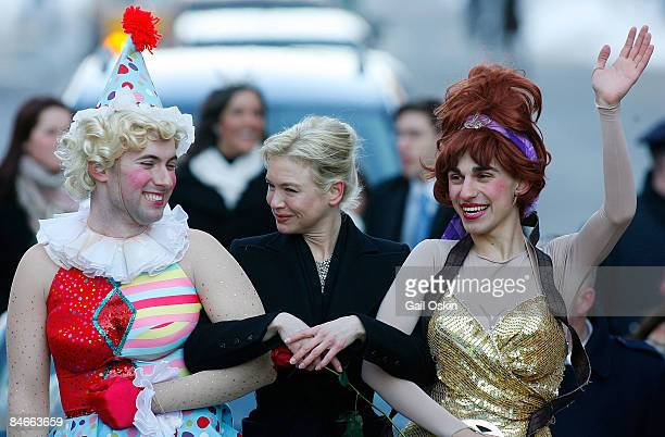 Tom Compton, Renee Zellweger, and Dave Andersson pose as Zellweger is honored as Harvard University's Hasty Pudding Club's 2009 Woman of the Year at...