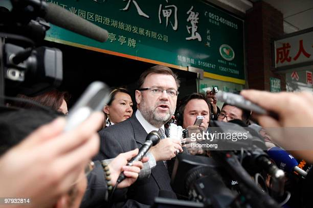 Tom Connor, Australia's consul general in Shanghai, speaks to reporters after leaving the Shanghai No. 1 People's Intermediate Court, in Shanghai,...