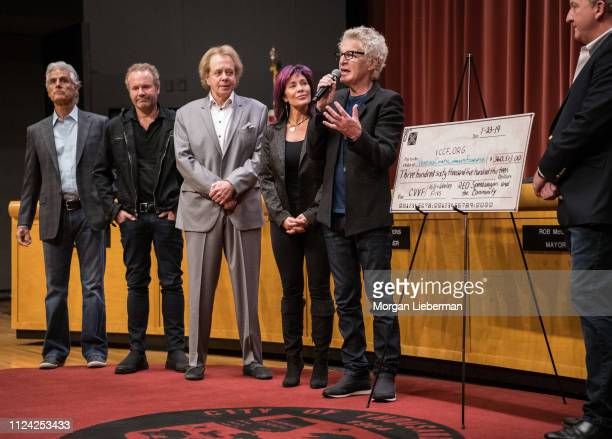 Tom Consolo John Ondrasik of Five For Fighting Eddie Money and Lisa and Kevin Cronin of REO Speedwagon during the check presentation from the benefit...
