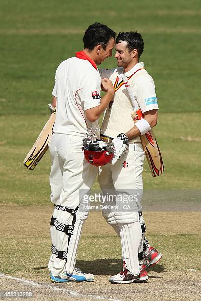 Tom Cooper and Callum Ferguson of the Redbacks celebrate after they hit the winning runs during day four of the Sheffield Shield match between South...