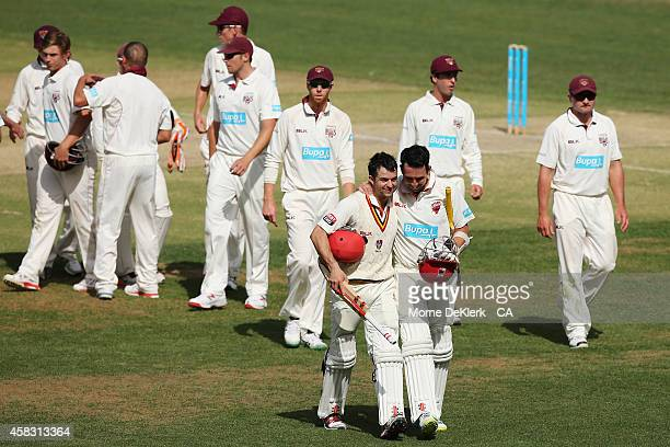 Tom Cooper and Callum Ferguson of the Redbacks celebrate as they come from the ground after they hit the winning runs during day four of the...