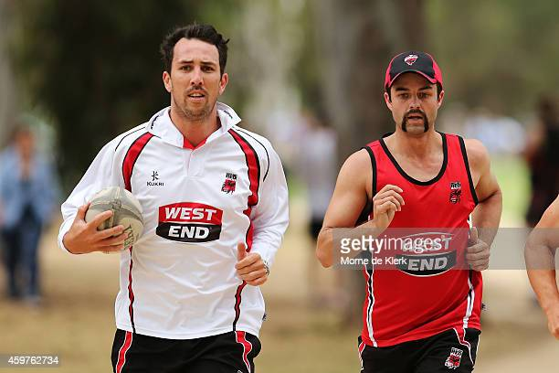 Tom Cooper and Callum Ferguson of the Redbacks run during a South Australian Redbacks training session at The Uni Loop on December 1 2014 in Adelaide...