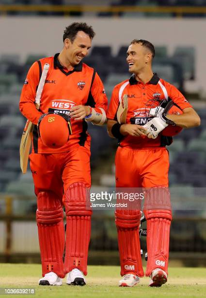 Tom Cooper and Jake Weatherald of SA share a laugh together after their win during the JLT One Day Cup match between South Australia and New South...