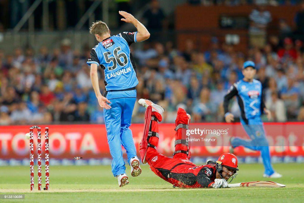 Tom Cooper of the Melbourne Renegades dives to beat a run out attempt during the Big Bash League match between the Adelaide Strikers and the Melbourne Renegades at Adelaide Oval on February 2, 2018 in Adelaide, Australia.
