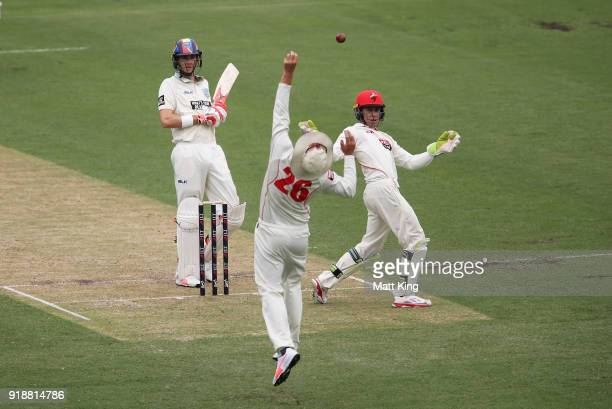 Tom Cooper of the Redbacks attempts to catch Kurtis Patterson of the Blues as Harry Nielsen of the Redbacks looks on during day one of the Sheffield...