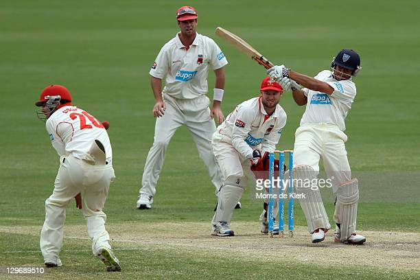 Tom Cooper of the Redbacks is struck by a ball hit by Usman Khawaja of the Blues during day four of the Sheffield Shield match between the South...