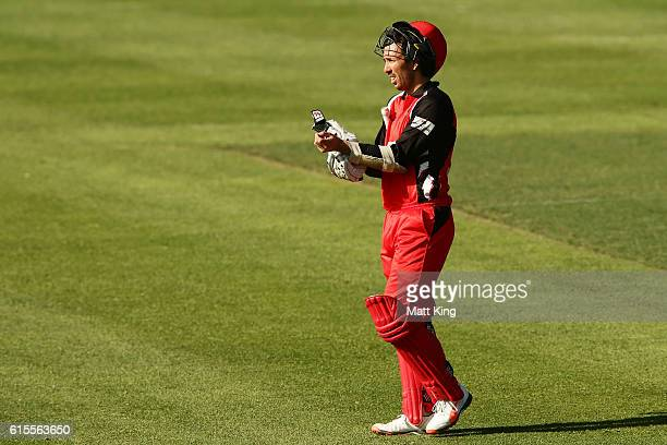 Tom Cooper of the Redbacks takes a drinks break during the Matador BBQs One Day Cup match between South Australia and Tasmania at Hurstville Oval on...