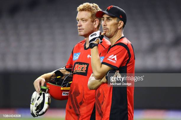 Tom Cooper of the Renegades listens to Renegades head coach Andrew McDonald during the Melbourne Renegades Big Bash League Team Photo Session on...