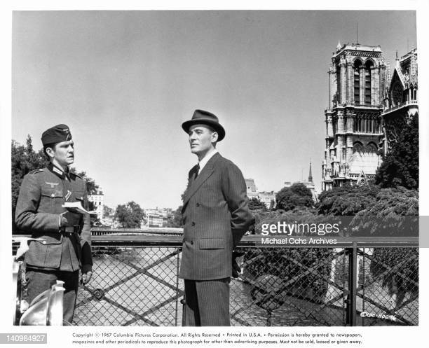 Tom Courtenay and Peter O'Toole standing on a bridge in a scene from the film 'Night Of The Generals', 1966.