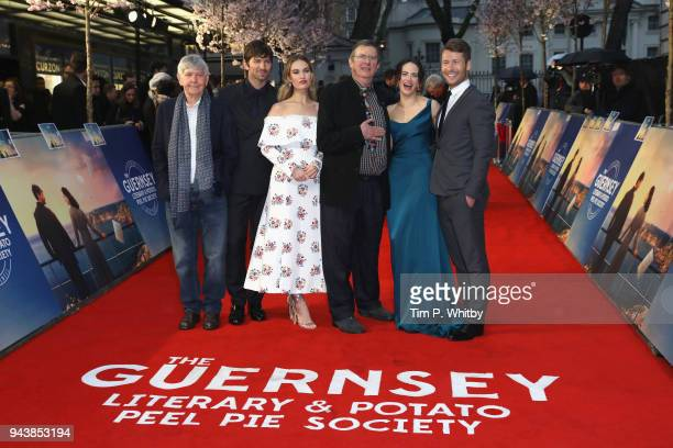 Tom Courtenay, Michael Hulsman, Lily James, Mike Newell, Jessica Brown Findlay and Glen Powell attend 'The Guernsey Literary And Potato Peel Pie...
