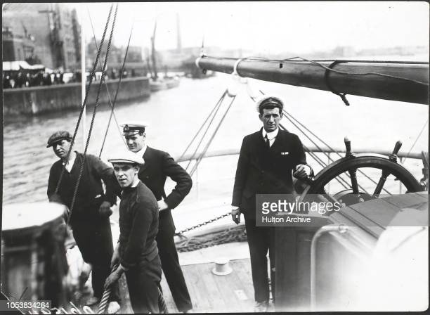 Tom Crean at the helm of the 'Endurance', as she leaves Millwall Dock in London on Ernest Shackleton's Imperial Trans-Antarctic Expedition, 1st...