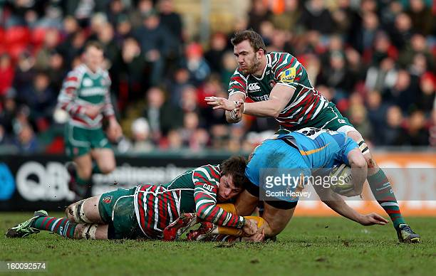 Tom Croft and Brett Deacon of Leicester Tigers tackle Will Taylor of London Wasps during the LV=Cup match between Leicetser Tigers and London Wasps...