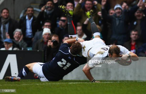 Tom Croft of England beats Dan Parks of Scotland to score the first try during the RBS 6 Nations Championship match between England and Scotland at...