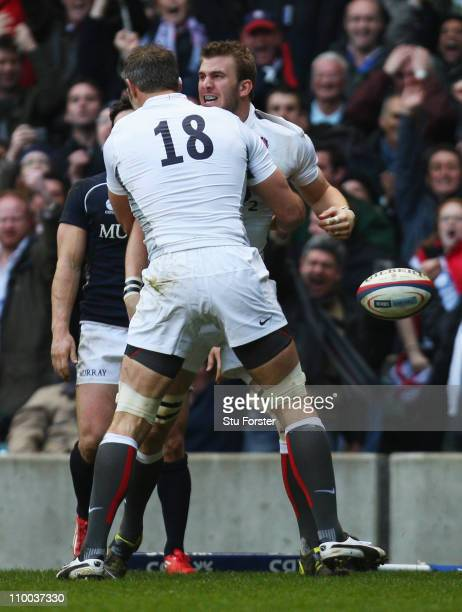 Tom Croft of England celebrates with Simon Shaw as he scores the first try during the RBS 6 Nations Championship match between England and Scotland...