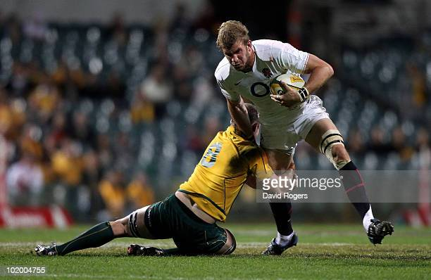 Tom Croft of England is tackled by Richard Brown during the Cook Cup Test match between the Australian Wallabies and England at the Subiaco Oval on...