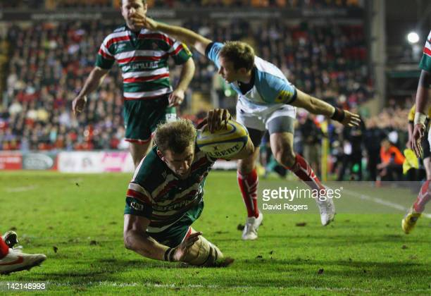Tom Croft of Leicester dives over for a try during the Aviva Premiership match between Leicester Tigers and Worcester Warriors at Welford Road on...