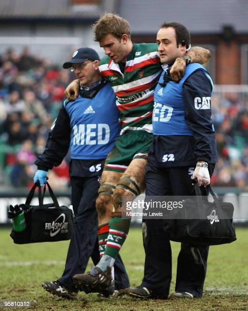 Tom Croft of Leicester is helped off the pitch during the Heineken Cup match between Leicester Tigers and Viadana at Welford Road on January 16 2010...