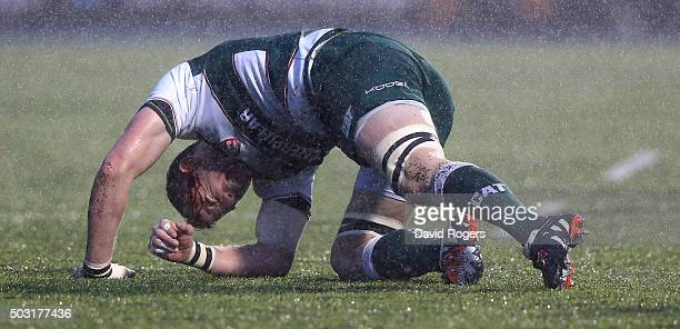 Tom Croft of Leicester is injured during the Aviva Premiership match between Saracens and Leicester Tigers at Allianz Park on January 2 2016 in...