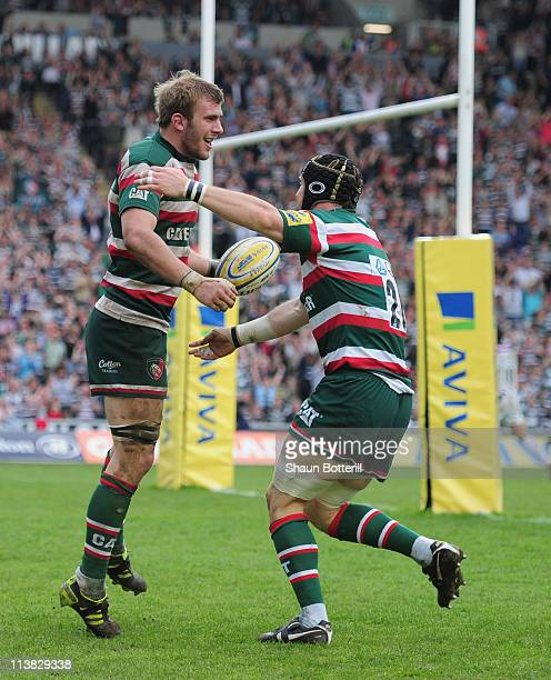 Tom Croft of Leicester Tigers celebrateswith teammate Ben Woods after scoring during the AVIVA Premiership match between Leicester Tigers and London...