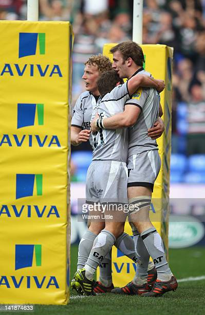 Tom Croft of Leicester Tigers is congratulated after scoring a try during the Aviva Premiership match between London Irish and Leicester Tigers at...