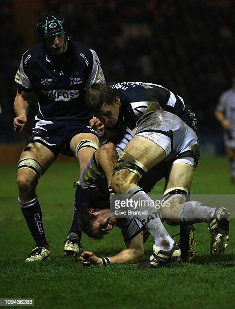 Tom Croft of Leicester Tigers is tackled by Kyle Tonetti of Sale Sharks during the AVIVA Premiership match between Sale Sharks and Leicester Tigers...