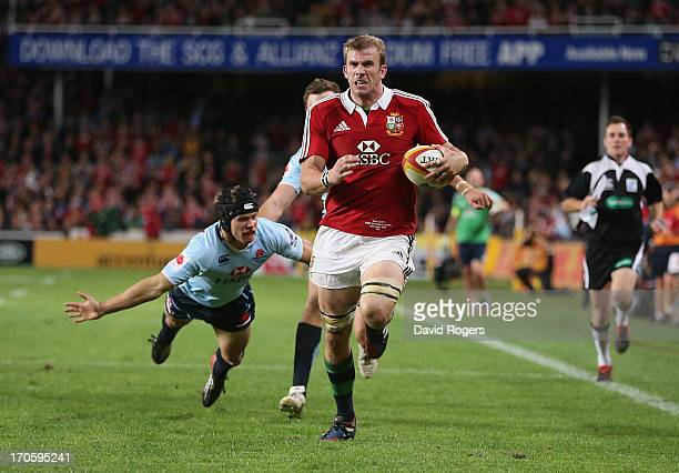 Tom Croft of the Lions breaks clear to score a try during the match between the NSW Waratahs and the British Irish Lions at Allianz Stadium on June...