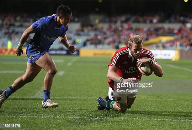Tom Croft of the Lions dives over for the third try during the tour match between the Western Force and the British Irish Lions at Patersons Stadium...