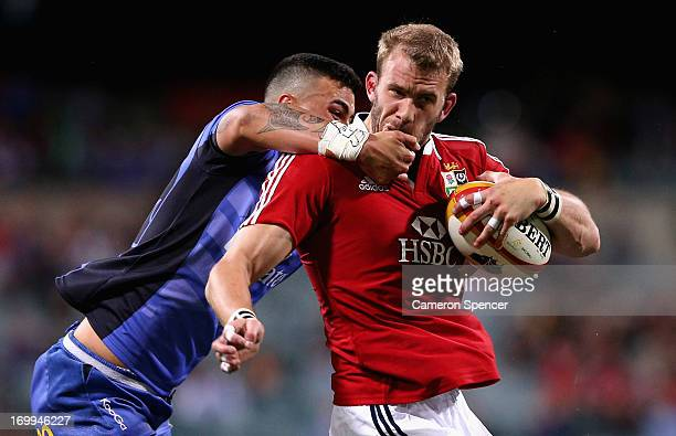 Tom Croft of the Lions is tackled high by Chris TuataraMorrison of the Force during the tour match between the Western Force and the British Irish...