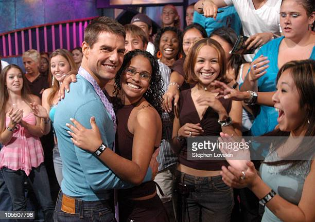 Tom Cruise and audience member during Tom Cruise Jamie Foxx and Jada Pinkett Smith Visit MTV's 'TRL' August 5 2004 at MTV Studios in New York City...