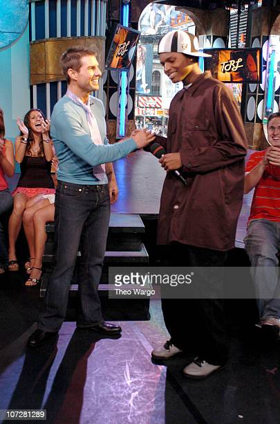 Tom Cruise and fan during Tom Cruise Jamie Foxx and Jada Pinkett Smith Visit MTV's TRL August 5 2004 at MTV Studios Times Square in New York City New...