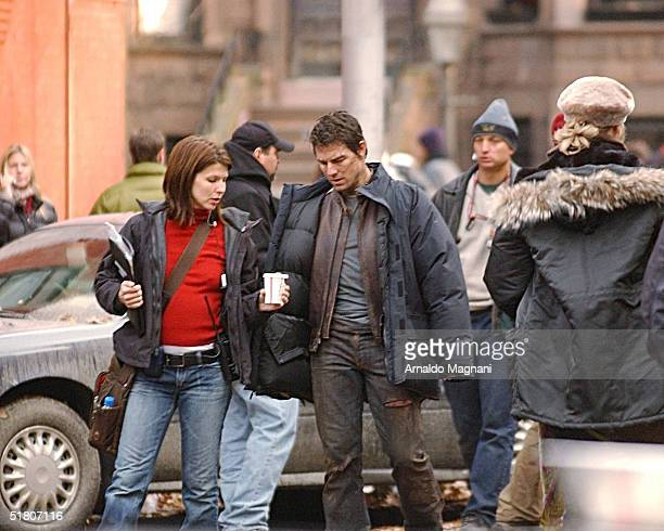 Tom Cruise and his assistant walk on the set of 'War of the Worlds' being filmed November 30 2004 in the Brooklyn Borough of New York City