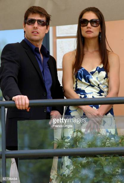 Tom Cruise and his girlfriend Katie Holmes stand on the terrace of the Casina delle Rose Restaurant at the Villa Borghese park April 29 2005 in Rome...