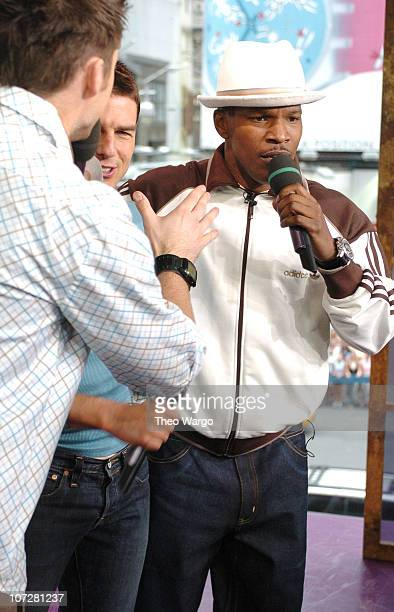 Tom Cruise and Jamie Foxx during Tom Cruise Jamie Foxx and Jada Pinkett Smith Visit MTV's TRL August 5 2004 at MTV Studios Times Square in New York...