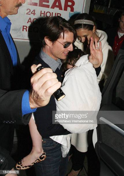 Tom Cruise and Katie Holmes with their daughter Suri attend the stage production of 'Jersey Boys The Story Of Frankie Valli The Four Seasons' at...
