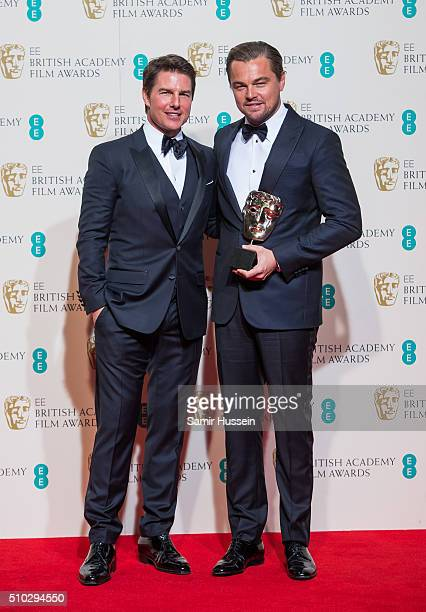 Tom Cruise and Leonardo DiCaprio pose in the winners room at the EE British Academy Film Awards at The Royal Opera House on February 14 2016 in...