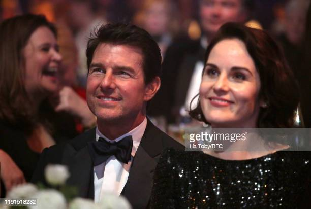 Tom Cruise and Michelle Dockery during The Fashion Awards 2019 held at Royal Albert Hall on December 02, 2019 in London, England.
