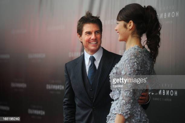 Tom Cruise and Olga Kurylenko attend the film premiere of 'Oblivion' at the Oktyabr cinema hall on April 1 2013 in Moscow Russia